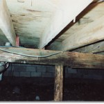 Water and rot damage in house foundation beams