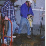 Crawl Space Repair team working on basement waterproofing